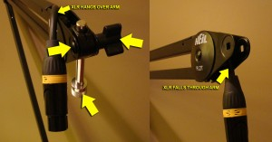 Shows XLR cable either hanging over arm, or going through arm.