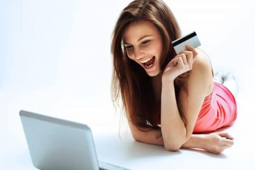 Woman with laptop and credit card getting ready to incorporate online today
